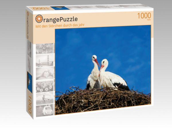 """Puzzle Motiv """"Mit den Störchen durch das Jahr"""" - Puzzle-Schachtel zu 1000 Teile Puzzle"""