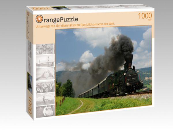 """Puzzle Motiv """"Unterwegs mit der dienstältesten Dampflokomotive der Welt."""" - Puzzle-Schachtel zu 1000 Teile Puzzle"""