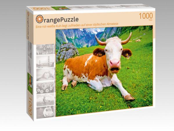 """Puzzle Motiv """"Eine rot-weiße Kuh liegt zufrieden auf einer idyllischen Almwiese"""" - Puzzle-Schachtel zu 1000 Teile Puzzle"""