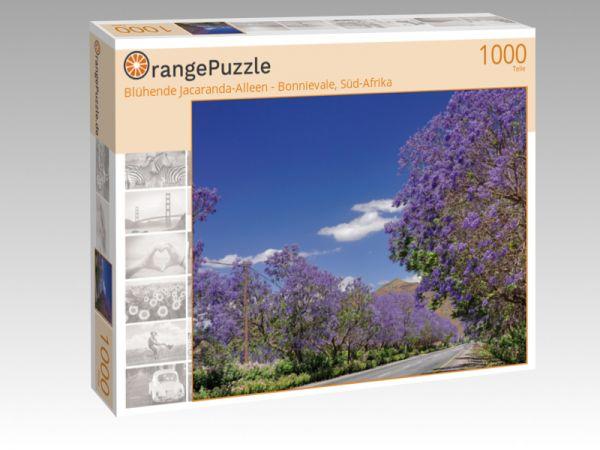 """Puzzle Motiv """"Blühende Jacaranda-Alleen - Bonnievale, Süd-Afrika"""" - Puzzle-Schachtel zu 1000 Teile Puzzle"""