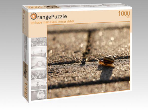 """Puzzle Motiv """"Ich habe mein Haus immer dabei"""" - Puzzle-Schachtel zu 1000 Teile Puzzle"""