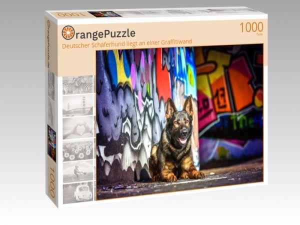 """Puzzle Motiv """"Deutscher Schäferhund liegt an einer Graffitiwand"""" - Puzzle-Schachtel zu 1000 Teile Puzzle"""