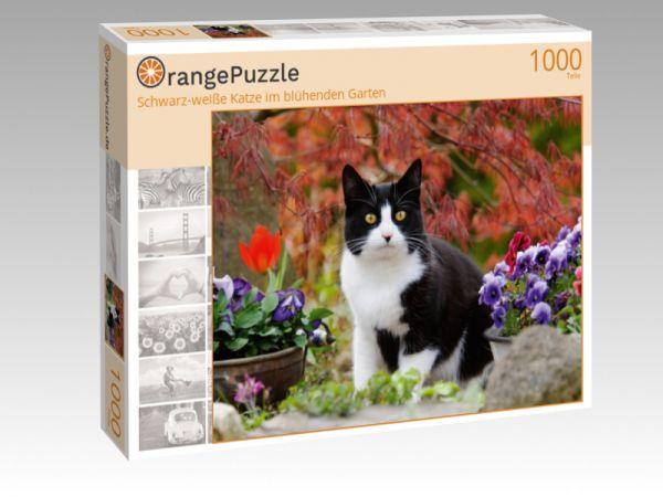 """Puzzle Motiv """"Schwarz-weiße Katze im blühenden Garten"""" - Puzzle-Schachtel zu 1000 Teile Puzzle"""