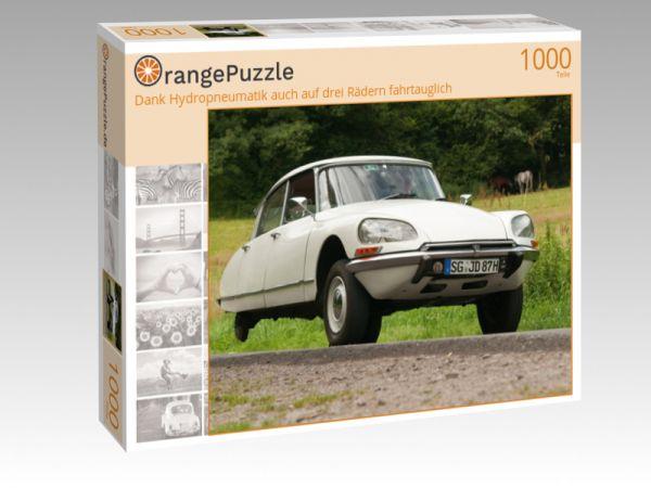 """Puzzle Motiv """"Dank Hydropneumatik auch auf drei Rädern fahrtauglich"""" - Puzzle-Schachtel zu 1000 Teile Puzzle"""